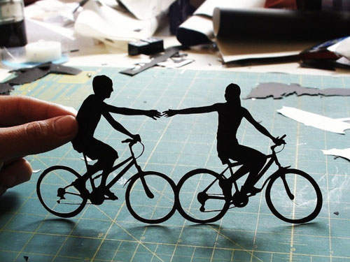 Papercut Silhouette Of Couple On Bicycles