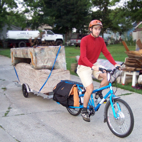 Yuba Modo Bicycle Trailer Hauling Two Sofas