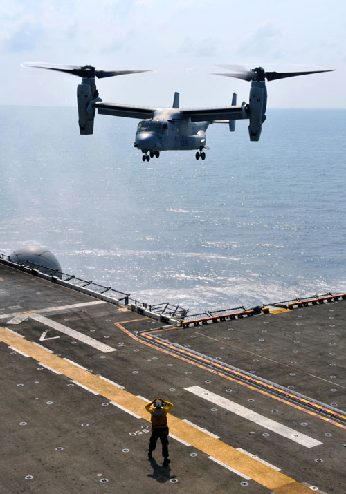 MV-22 Osprey Helicopter Approaching An Aircraft Carrier