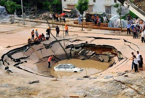 Car In Sink Hole
