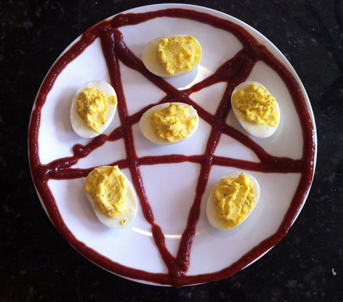 Deviled Eggs On A Plate With A Ketchup Pentagram