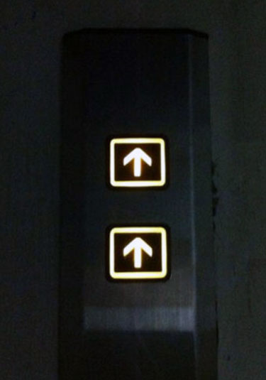 Two Elevator Up Buttons