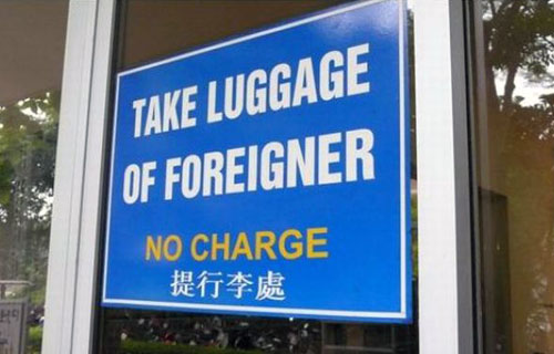 Take Luggage of Foreigners Sign