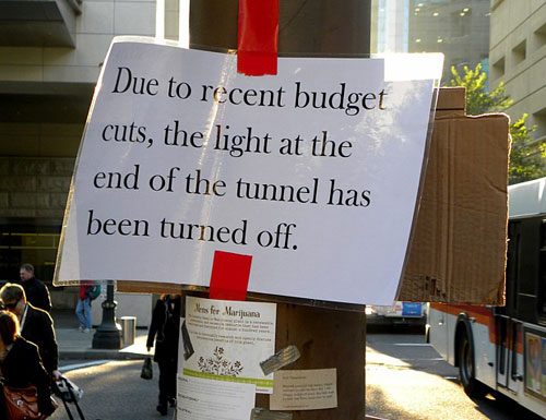Sign at Occupy Portland - Due To Recent Budget Cuts, The Light At The End Of The Tunnel Has Been Turn Off