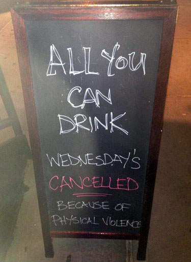 Sign Announcing All You Can Drink Cancelled