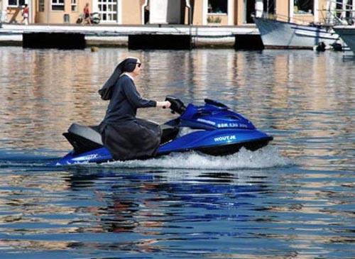 Nun Riding A Jet Ski