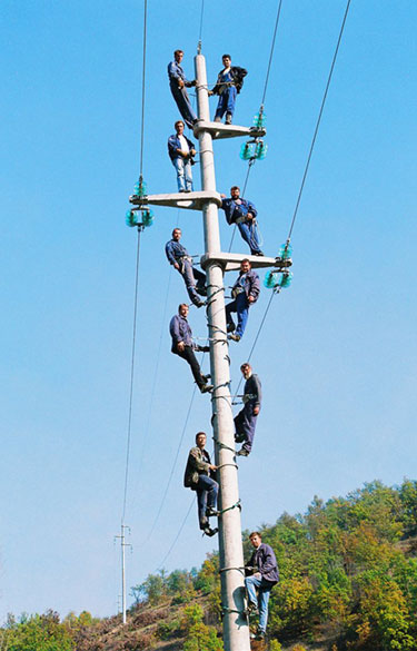 Electricians Staff Photo On A Pole