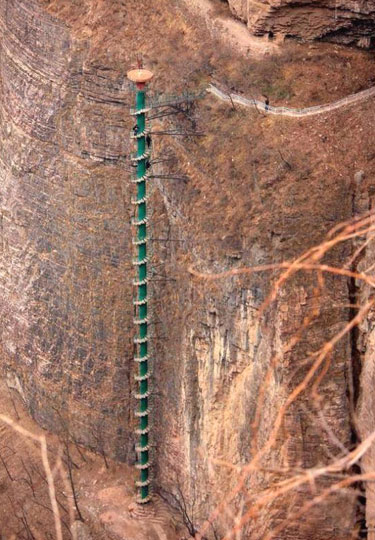 Extremely Tall Spiral Staircase On The Side Of A Cliff In China