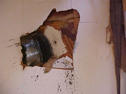 Piston Embedded In A Wall